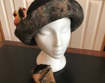Stylish wet felted hat in merino and silk with hand beaded embellishment