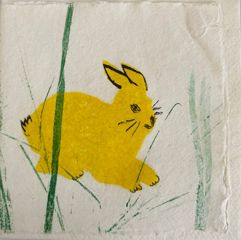Yellow Bunny in the grass 4 image 0