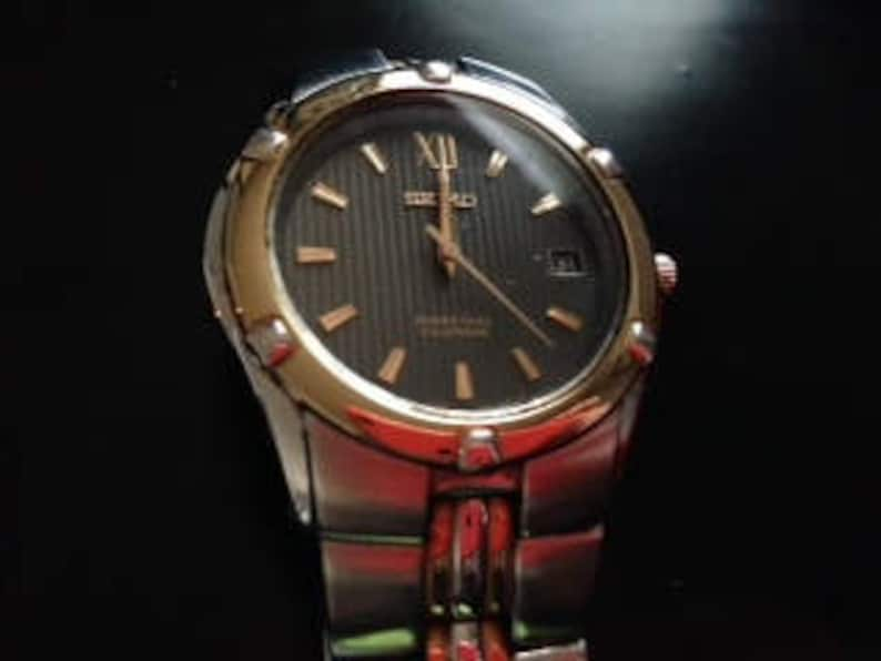 Seiko Perpetual Calendar.Seiko Perpetual Calendar Silver And Gold Tone Watch