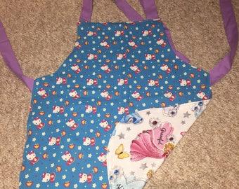 Child's reversible apron - Hello Kitty/Disney Princesses