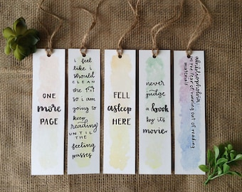 colorful watercolor bookmarks with twine tassle » funny calligraphy sayings » one more page » fell asleep here » never judge a book