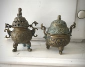 Two antique Chinese antique censers, temple Zhengde and Qianlong mark decorated with bats, clouds, Ruyi and Shao symbols 19th century