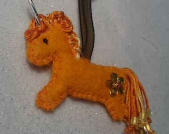 Orange Unicorn with beaded tail, lavender stuffed.