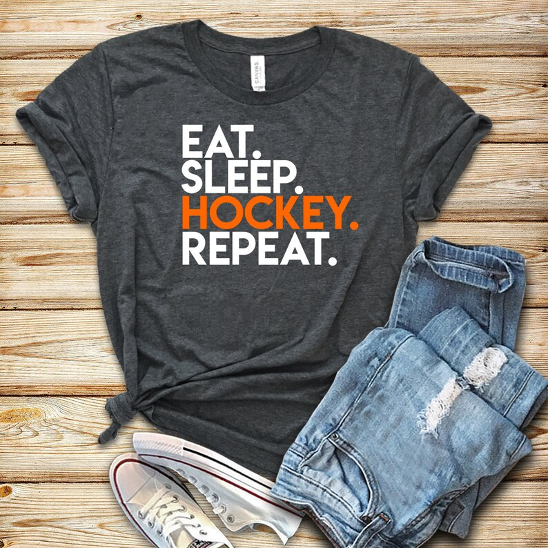 Eat Sleep Hockey Repeat / Unisex T-Shirt / Tank Top / Hoodie / image 0
