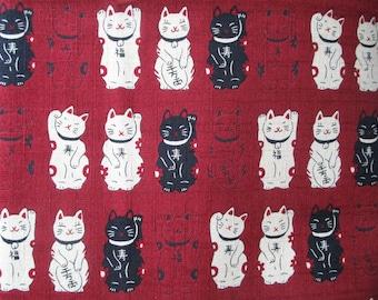 Japanese fabric red background manekineko dark 50 x 55 cm