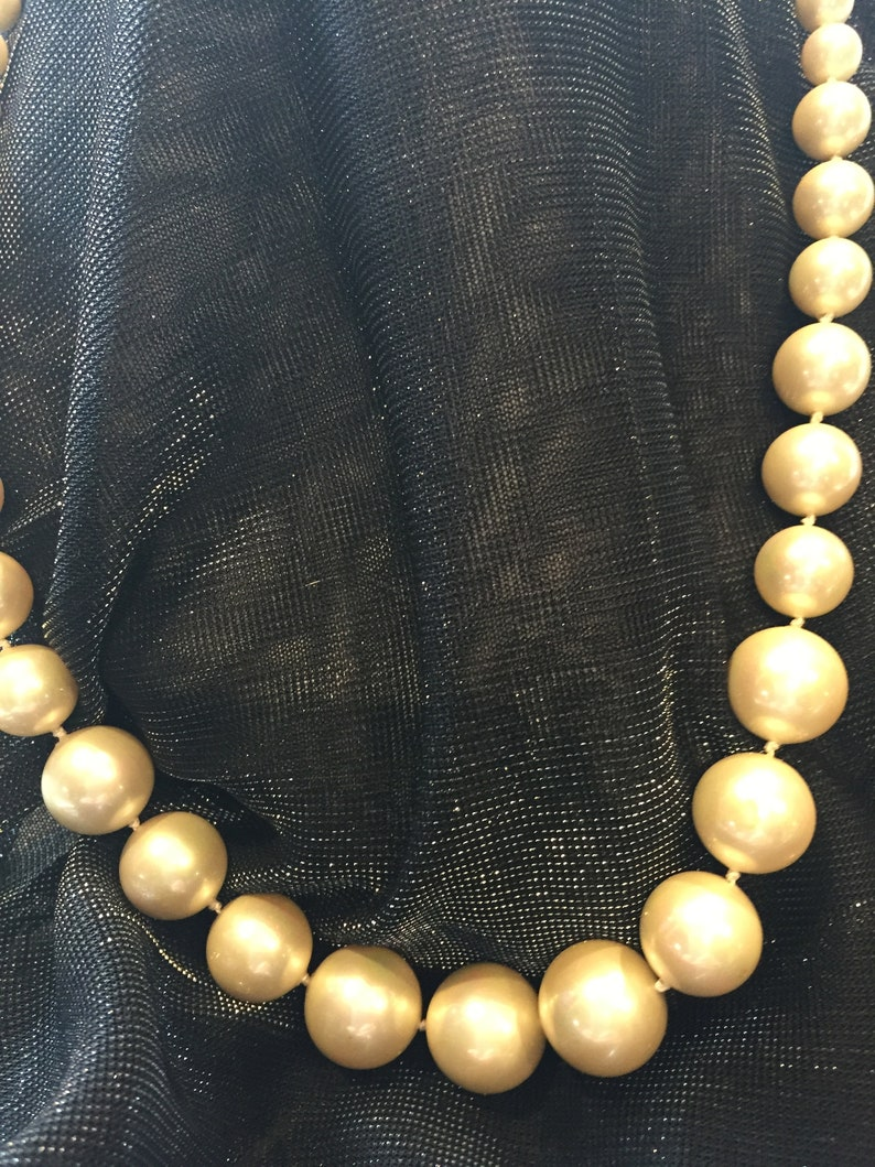 KNOTTED natural colour  GLASS    pearls    graduated 8 to 16   mm  beads   21 inches in  length knotted on pink silk