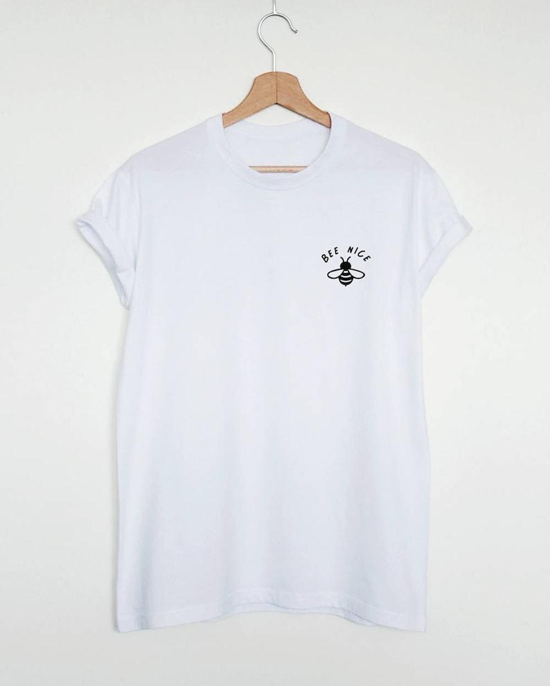e212a9898d Cute pocket print T-shirt Bee nice shirt funny womens or   Etsy
