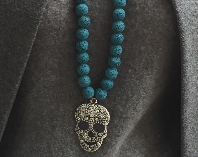 Pendant necklace, Beaded necklace with skull pendant and blue lava stone beads