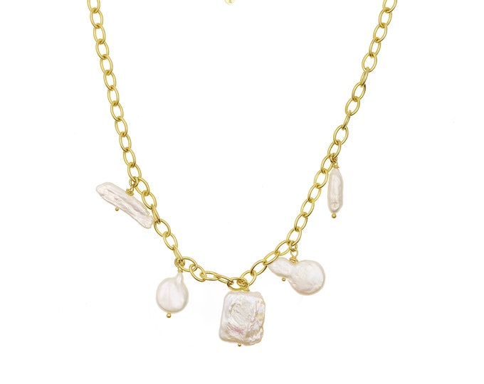 Golden necklace and white pearls