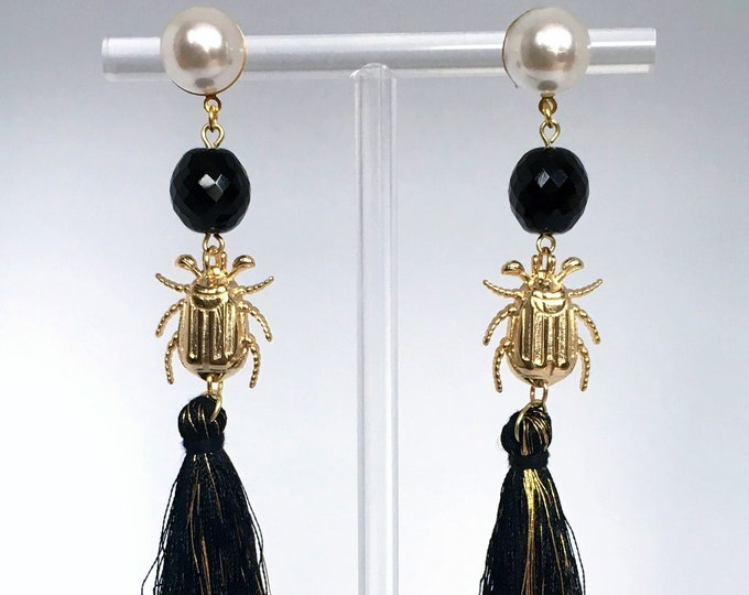 Tassel drop earrings, Black tassel and golden scarab drop earrings