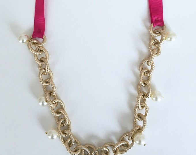 Long statement necklace and white beads