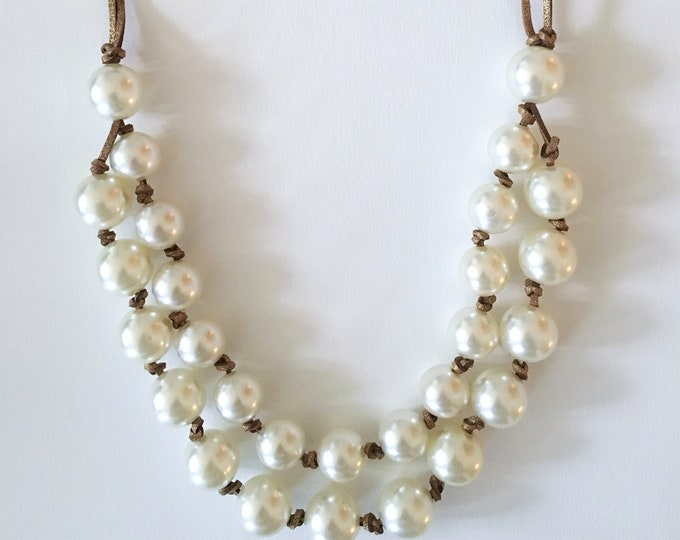 White beaded necklace and bronze lace