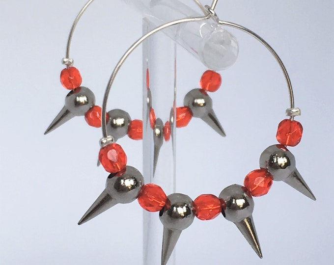 Silver plated hoop earrings with metal and orange glass beads