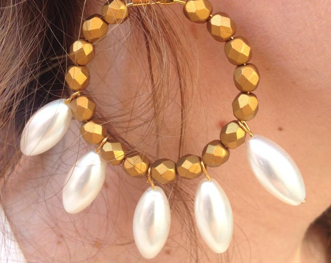 Hoop earrings and white beads