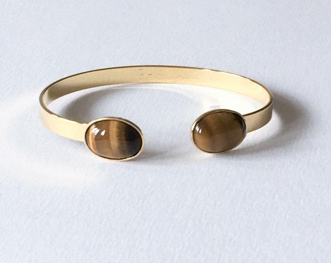 Stone bracelet, 24 karat golden cuff bracelet and tiger eye gemstone