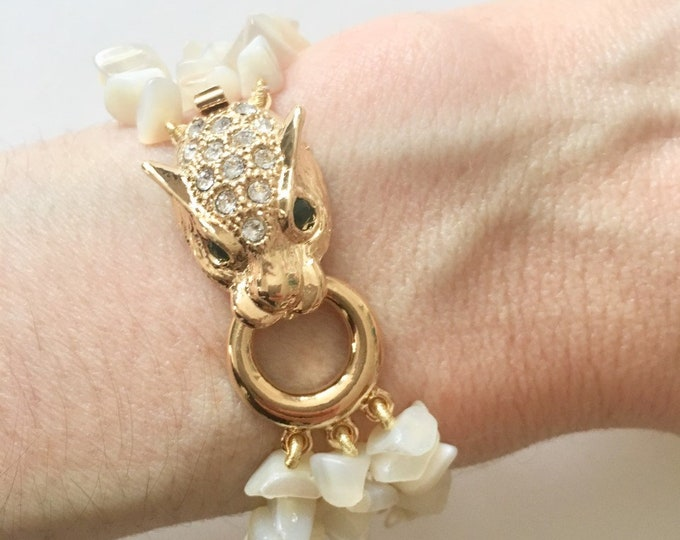 Mother of pearl cuff bracelet, with a golden tiger clasp