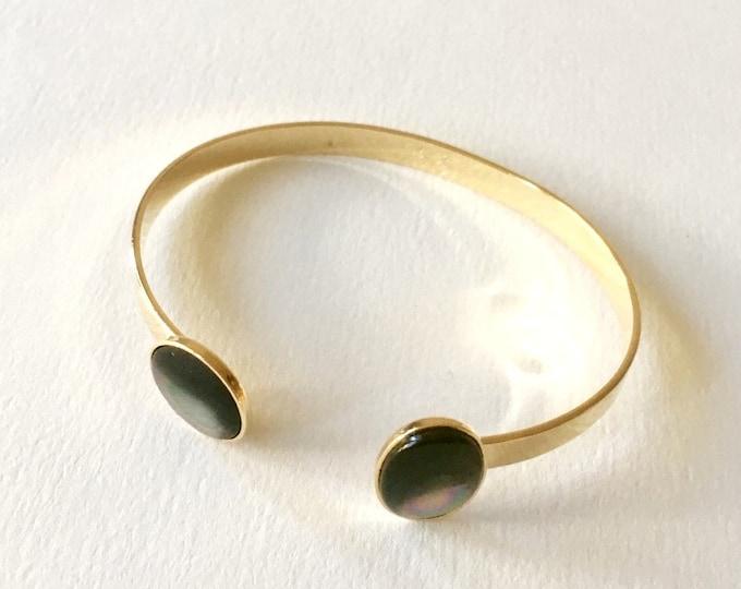 Stone bracelet, 24 karat golden cuff bracelet and grey mother of pearlgemstone