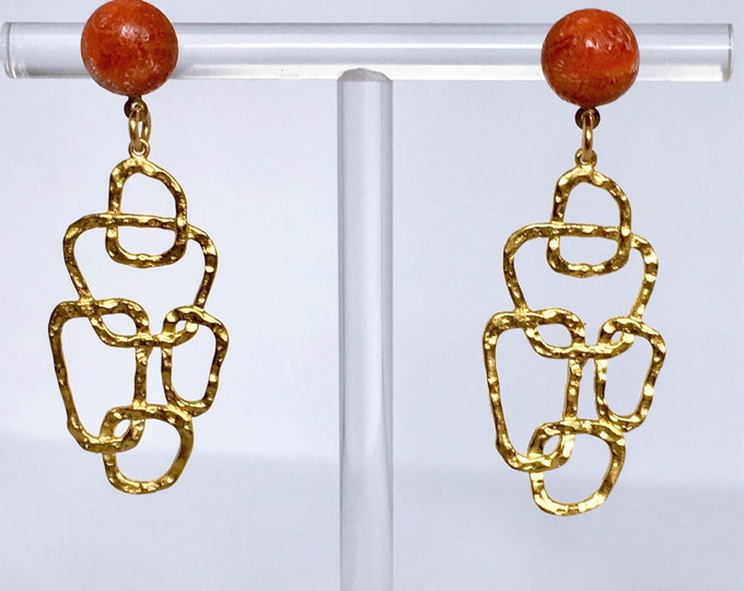 Golden drop earrings and coral gemstones