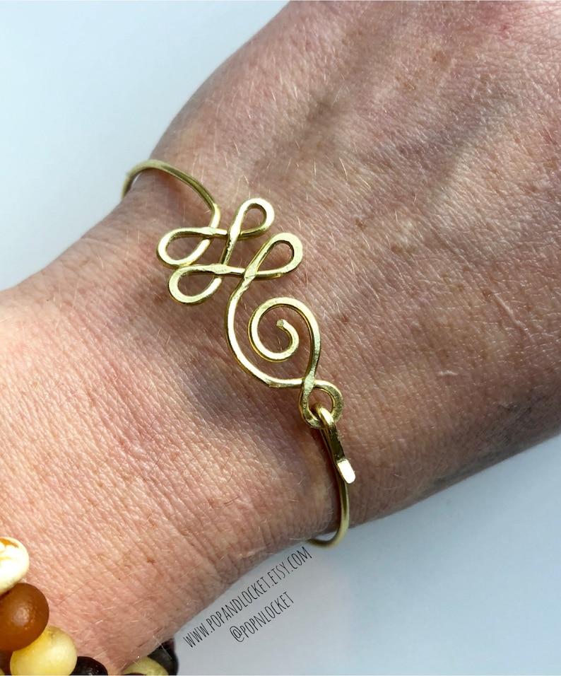 sterling silver copper Buddhist Unalome cuff bracelet in brass