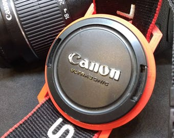 Lens Cap Holder for DSLR camera caps 37-98mm in size and in a range of colours. Fully customisable.