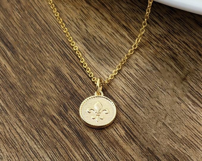 gold fleur de lis, fleur de lis necklace, fleur de lis charm, fleur de lis jewelry, gold fleur de lis necklace, new orleans saints logo