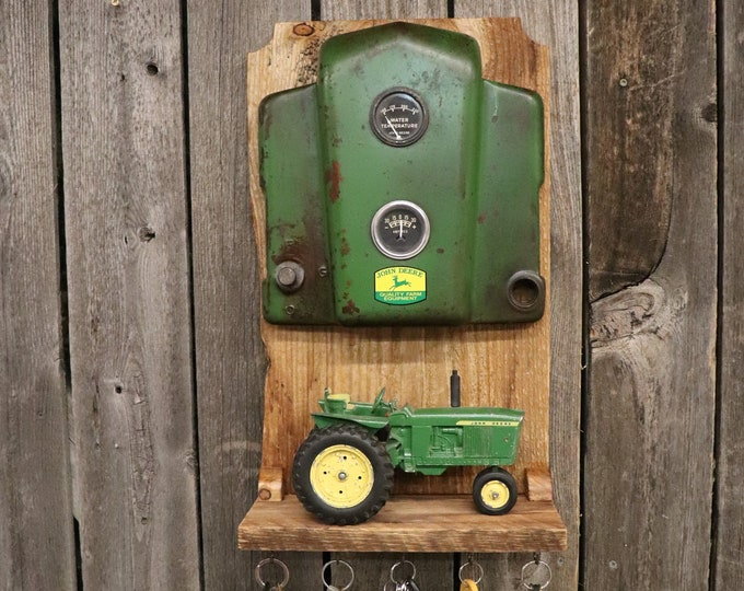 John Deere Tractor Dash Shelf and Key Holder with rustic barn boards. Perfect for your entryway. Use the shelf for letters or a toy tractor.