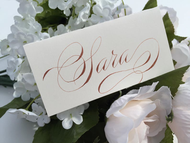 Flourished copper place cards for weddings dinners celebrations Calligraphy place cards Custom fancy wedding place cards Gala script