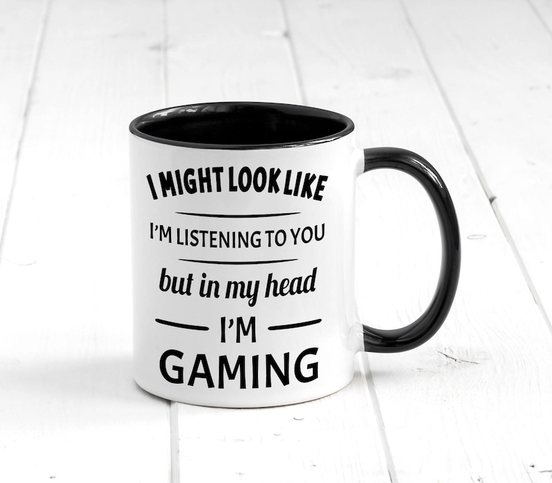 I MIght Look Like I'm Listening To You Buy in my Head I'm Gaming Mug