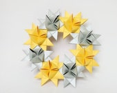 Winter wreath in gold and silver made of 8 moravian paper stars, beautiful door and wall decor for winter