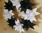 Winter wreath made of 8 moravian paper stars, beautiful door and wall decor for winter, black and white colored wreath