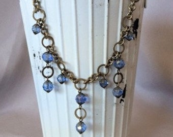 Sapphire Blue and Antique Gold Crystal Chandelier Necklace; Blue and Gold Dangle Necklace; Blue and Gold Chain Necklace; Bib Necklace