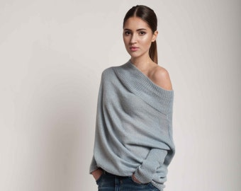 Light sweater with turtleneck in blue.