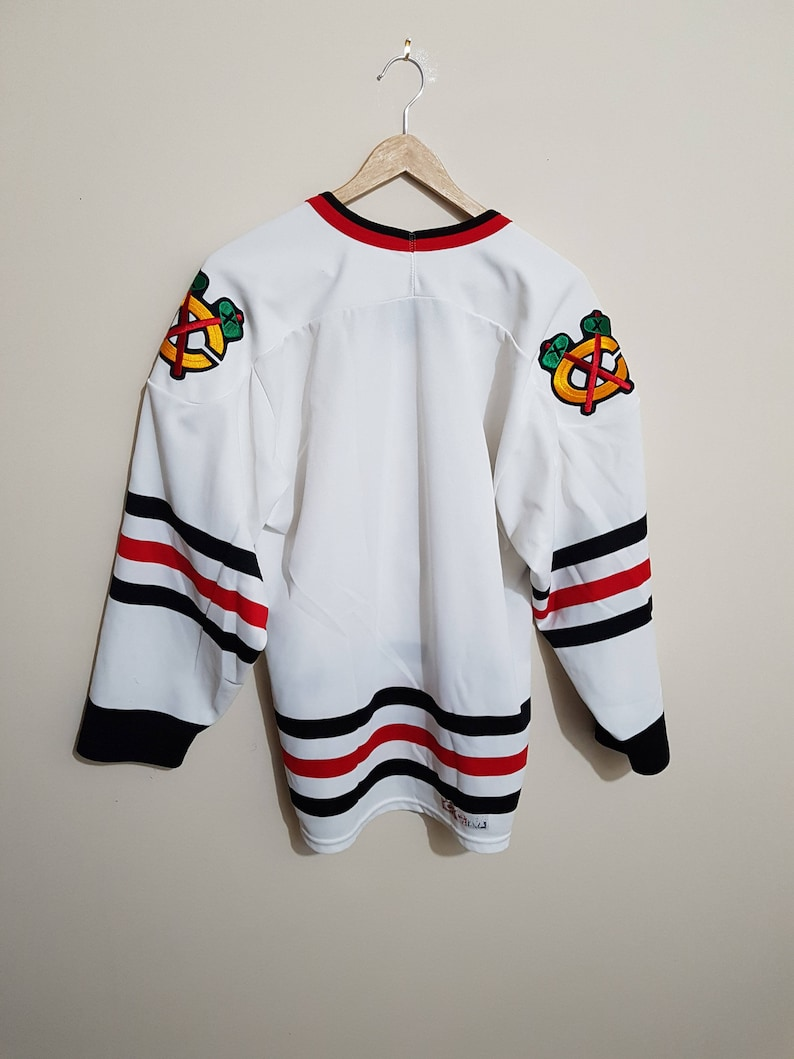 9a8f070bb57 Vintage Chicago Blackhawks jersey 90s Chicago jersey 90 s | Etsy
