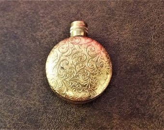 Gold tone, metal covered pendent perfume bottle