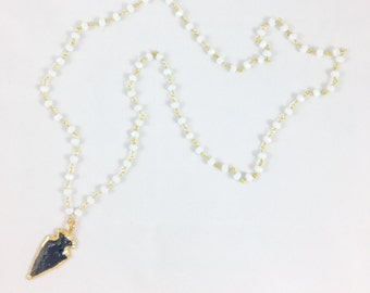 Black obsidian arrow pendant and white beaded necklace
