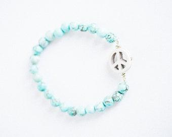 Turquoise and ivory beaded peace bracelet