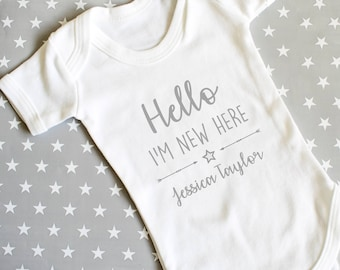 39613c5dd90d7 Personalised Hello World I m New Here Baby Grow