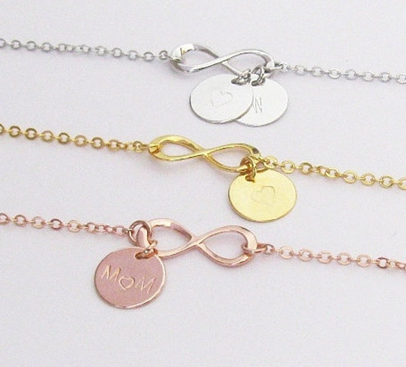 f69948805aea4 Infinity Charm Bracelet with Hand Stamped Initial Disc Charms – Add Up to 5  Charms in Gold, Silver or Rose Gold Plated