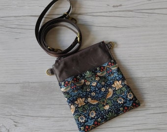 Small Cellphone Pocket Walking Bag. Perfect size for your Cell, Keys, Passport and Cash or Cards. Simple, Functional Design.