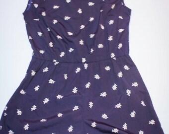Short jumpsuit floral blue background size 44