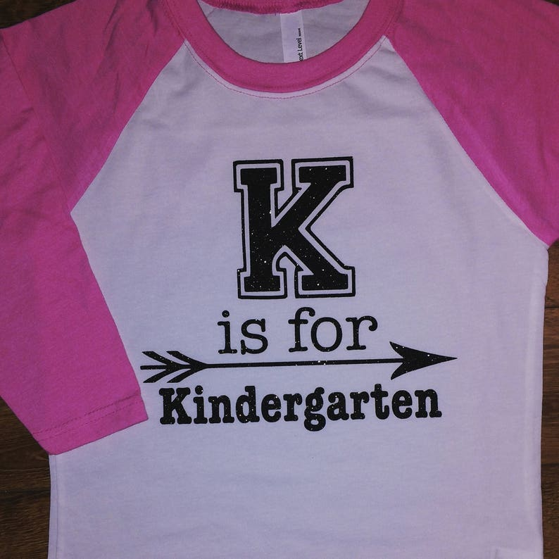 20404536a28 K is for Kindergarten youth raglan shirt with glitter