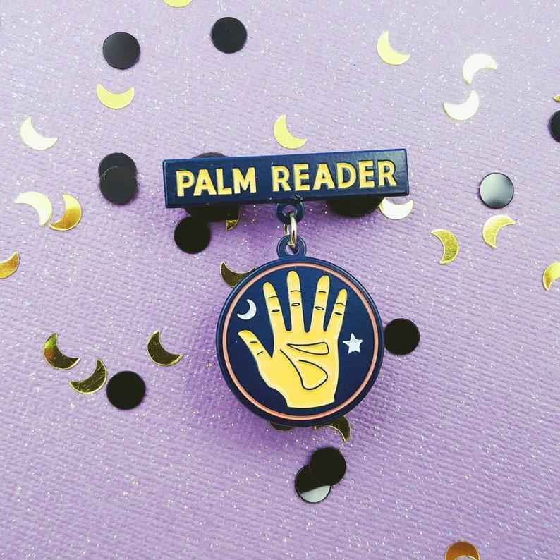 Palm Reader Dangling Enamel Pin image 0