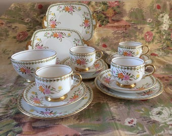 REDUCED: Pretty and heavily gilded 15 piece Royal Stafford bone teaset with striking pink and orange handpainted floral detail.