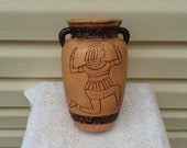 Vintage Pottery Vase with Human on Front and Jars on Back