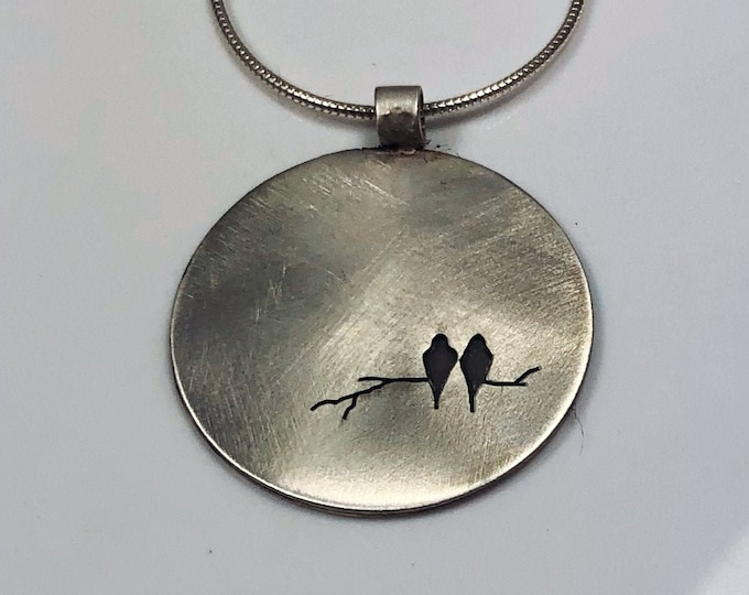 Birds on a branch round sterling pendant