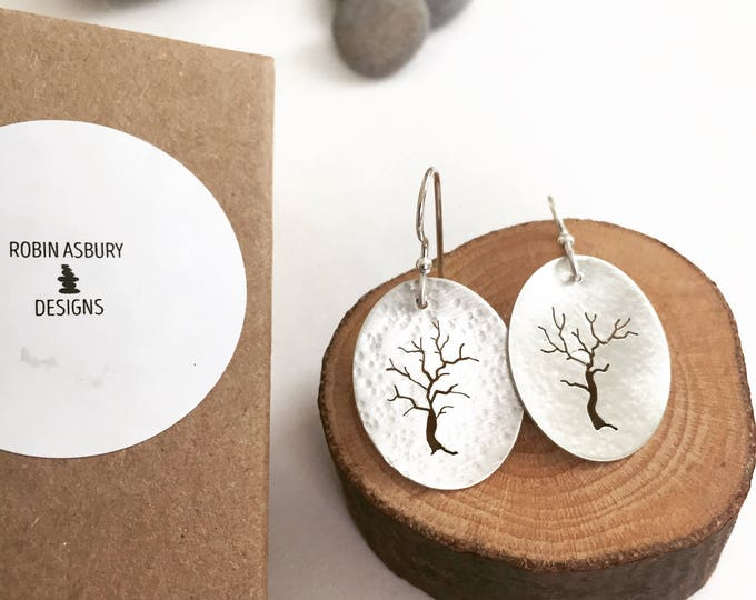 hand pierced sterling tree earrings with silver bead.