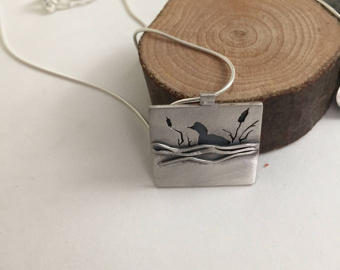 small, square, sterling silver loon pendant