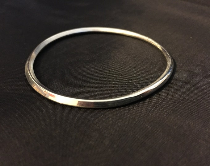 Hand forged sterling silver bangle square to round