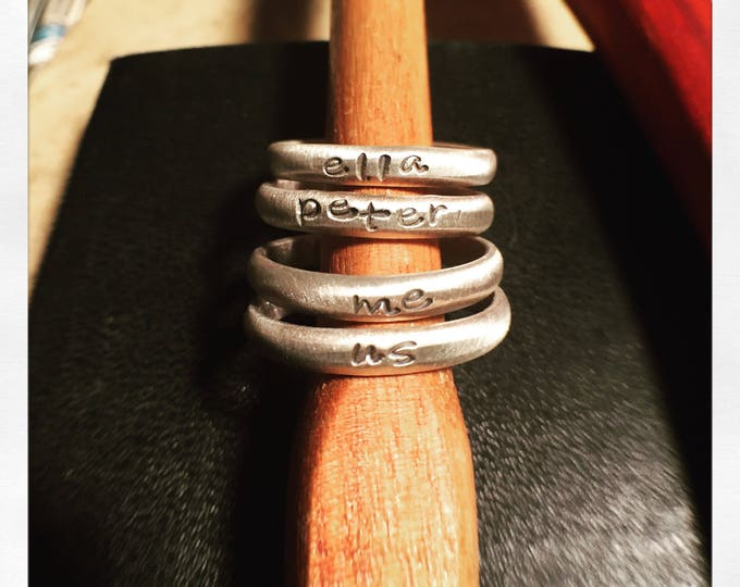 Custom made hand stamped sterling silver rings