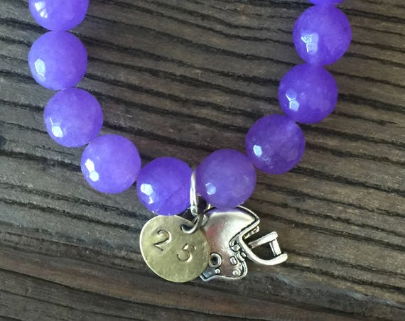 "12mm Periwinkle purple jade faceted bead bracelet with silver plated football helmet charm and hand stamped ""25"" charm"